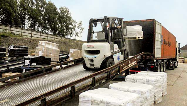 Loading goods using one of our three mobile loading ramps.